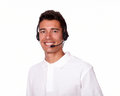 Smiling young man talking on a microphone. Royalty Free Stock Photo
