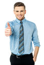 Smiling young man with thumbs up gesture Stock Photography