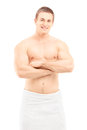 Smiling young man in towel posing after shower isolated on white background Stock Images