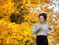 Smiling young sports woman running outdoors Royalty Free Stock Photo