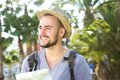 Smiling young traveling guy holding map outside portrait of a Royalty Free Stock Photos