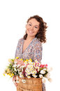 smiling young woman with basket of flowers Royalty Free Stock Photo