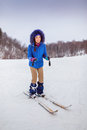 Smiling young woman beginner skier in winter happy forest Stock Photo