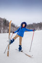 Smiling young woman beginner skier in winter happy forest Royalty Free Stock Photos