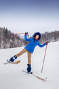 Smiling young woman beginner skier in winter happy forest Stock Image