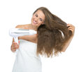 Smiling young woman blow dry isolated on white background Royalty Free Stock Images