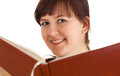 Smiling young woman with book Royalty Free Stock Image