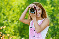 Smiling young woman with camera Stock Photography