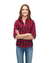 Smiling young woman in casual clothes happiness and people concept with crossed arms Royalty Free Stock Photography