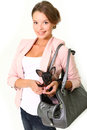 Smiling young woman with Chihuahua in a bag isolated on white Royalty Free Stock Photo