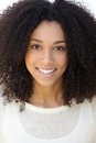 Smiling young woman with curly hair close up portrait of a Royalty Free Stock Photos