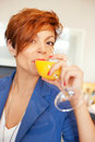 Smiling young woman drinking fresh fruits Royalty Free Stock Photo