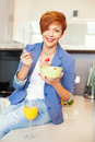 Smiling young woman eating fresh fruits Royalty Free Stock Photo