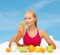 Smiling young woman eating healthy breakfast fitness diet and healthcare concept with and drinking orange juice Royalty Free Stock Images