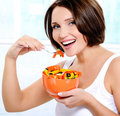 Smiling young woman eats  salad Stock Photography