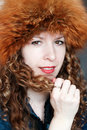 Smiling young woman in fur hat Stock Images