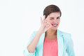 Smiling young woman gesturing okay sign in white background Royalty Free Stock Image