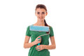 Smiling young woman in a green shirt keeps near yourself roller for painting walls Royalty Free Stock Photo