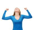 Smiling young woman with hands up Royalty Free Stock Image