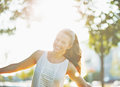 Smiling young woman having fun in city park white dress Stock Photography