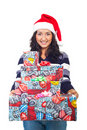 Smiling young woman holding presents Royalty Free Stock Images