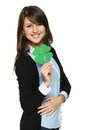 Smiling young woman holding shamrock leaf isolated on white background Royalty Free Stock Images