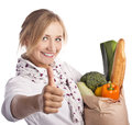 Smiling young woman holding a shopping bag Royalty Free Stock Image