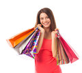 Smiling young woman holding shopping bags cute and isolated on white Royalty Free Stock Photo