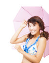 Smiling young woman holding a umbrella isolated on white background Royalty Free Stock Photography