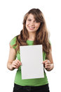 Smiling young woman holding a white blank card cheerful is she is isolated on background Stock Image