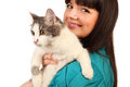 Smiling young woman holds cat isolated Stock Images