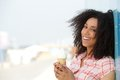 Smiling young woman with ice cream close up portrait of a cone outdoors Royalty Free Stock Images