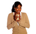 Smiling young woman looking at you with a mug Stock Images