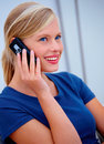 Smiling young woman making a call Stock Photo