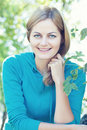 Smiling young woman outdoors Royalty Free Stock Image