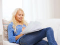 Smiling young woman with papers at home tax finances and happiness concept Royalty Free Stock Photography