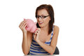 Smiling young woman with the piggybank. Stock Image