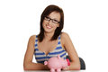 Smiling young woman with the piggybank. Stock Images