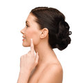 Smiling young woman pointing to her cheek beauty spa and health concept Royalty Free Stock Photo