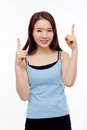 Smiling young woman pointing upwards Royalty Free Stock Photo