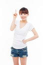 Smiling young woman pointing upwards isolated on white background Royalty Free Stock Images