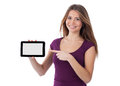 Smiling young woman presenting an electronic tablet Royalty Free Stock Photography