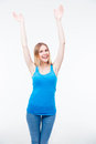 Smiling young woman with raised hands up isolated on a white background looking at camera Stock Photos