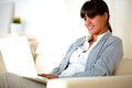 Smiling young woman reading the laptop screen Royalty Free Stock Photo