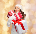 Smiling young woman in santa helper hat with gifts Royalty Free Stock Photo