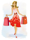 Smiling young woman with shopping bags in the dress Royalty Free Stock Photography