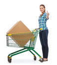 Smiling young woman with shopping cart Royalty Free Stock Image