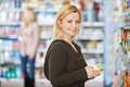Smiling young woman shopping at supermarket portrait of caucasian women Stock Photography