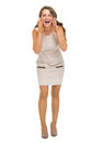 Smiling young woman shouting through megaphone shaped hands full length portrait of Royalty Free Stock Photography