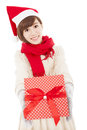 Smiling young woman showing christmas gift box asian Stock Image